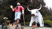Paul Bunyan and Babe stand outside the Trees of Mystery