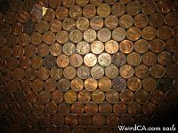Pennies in the front of the bar