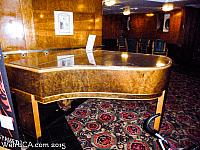 Piano to the right of the Front Desk