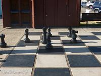 Several of the black chess pieces from the Morro Bay Chess Set
