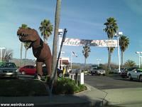 SLO Dinosaur guards the Auto Dealerships
