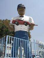 Tony of Tony's Transmissions holds up a car in Los Angeles