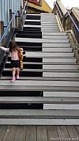 Tiffany walking down the piano staircase on Pier 39