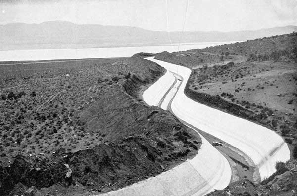 The Los Angeles Aqueduct next to a filled Owens Lake